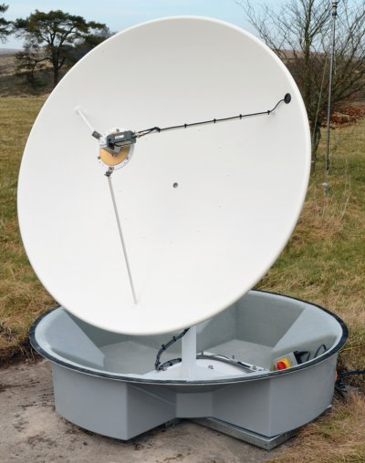 Radome removed from land-based antenna to show 1.5m parabolic dish antenna, scalar feed horn and LNB